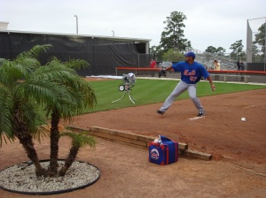 Santana lets another pitch fly during his bullpen session.