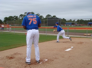 Jeurys Familia (75) and Matt Harvey warm up in the bullpen.