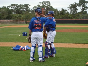 Josh Thole and Mike Nickeas chat during batting practice.