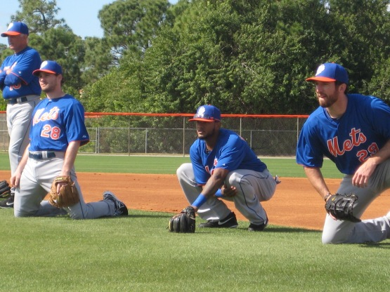 Daniel Murphy, Jordany Valdespin and Ike Davis participate in fielding drills while manager Terry Collins looks on.