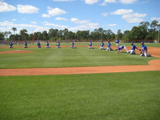 Mets infielders line up for fielding drills.